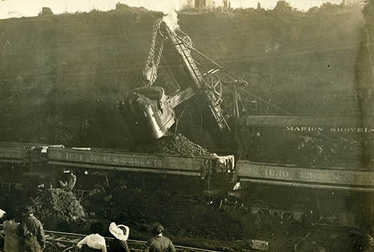 Steam shovel moving earth from the cut just west of present SW 45th to the ravine further west. ca. 1913.