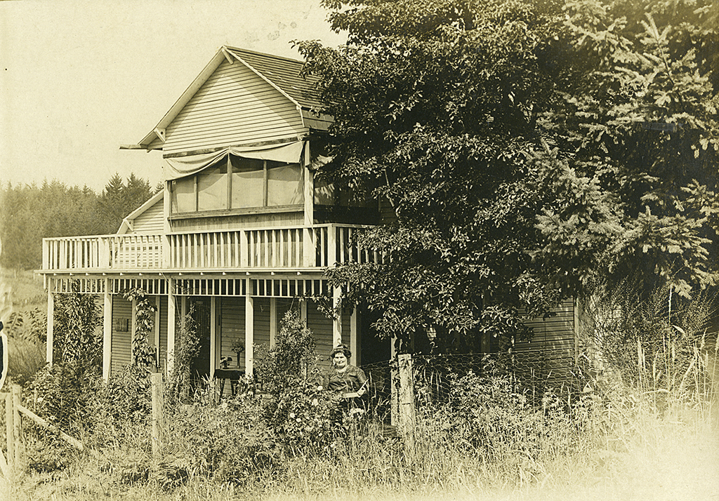 Front, Postcard of House and woman (probably Maggie Baron) in Multnomah, ca. 1920