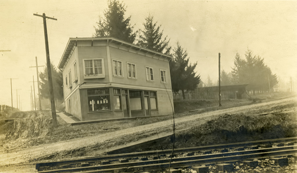 Multnomah Paint Store, ca. 1913. Capitol Highway and Oregon Electric RR in foreground.