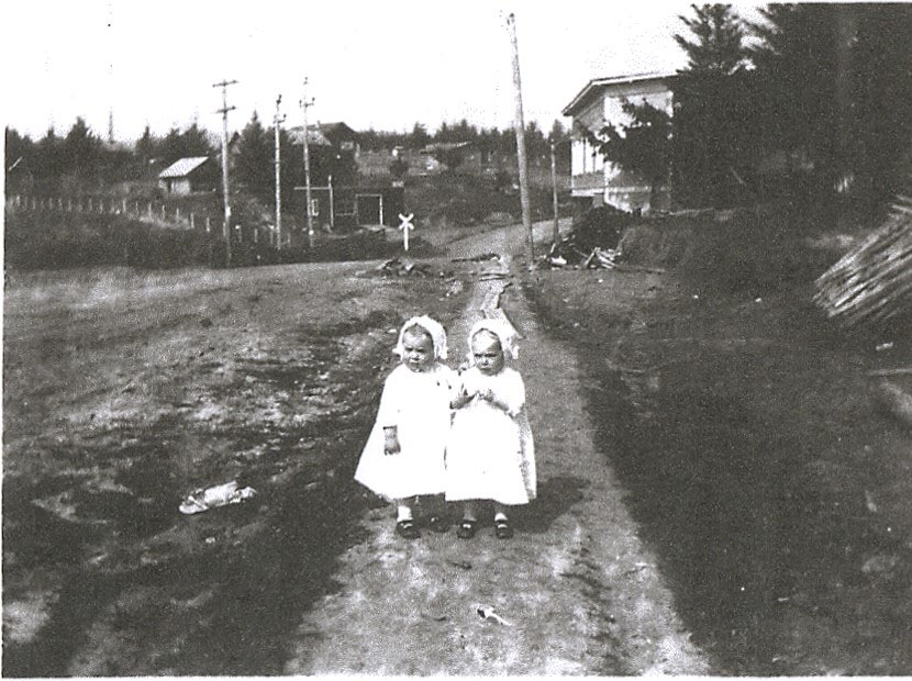 Rita and Lita Robinson on Capitol Highway, ca. 1913. Multnomah Crossing and paint store in background.