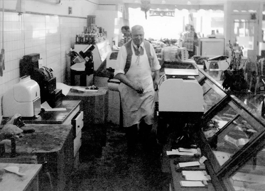 John Feuz in John's Market., ca. 1955.