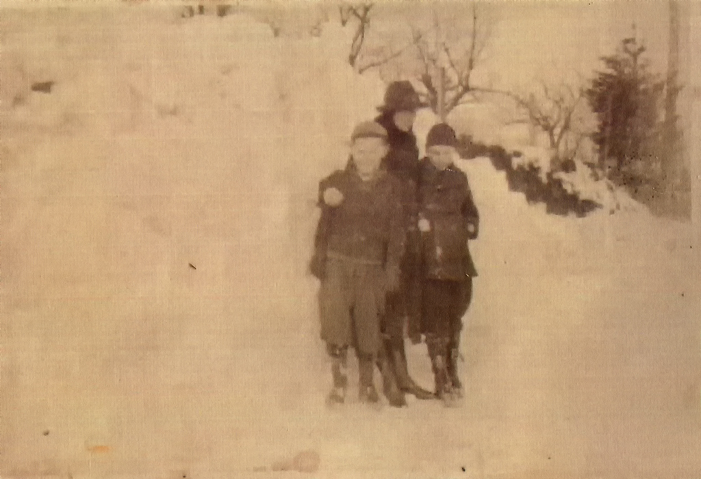 Unidentified woman and two unidentified boys in snow at Multnomah, Oregon, ca. 1920.