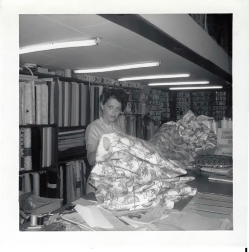 """Marion Miller, in her shop """"Sewing Basket,"""" ca. 1965."""